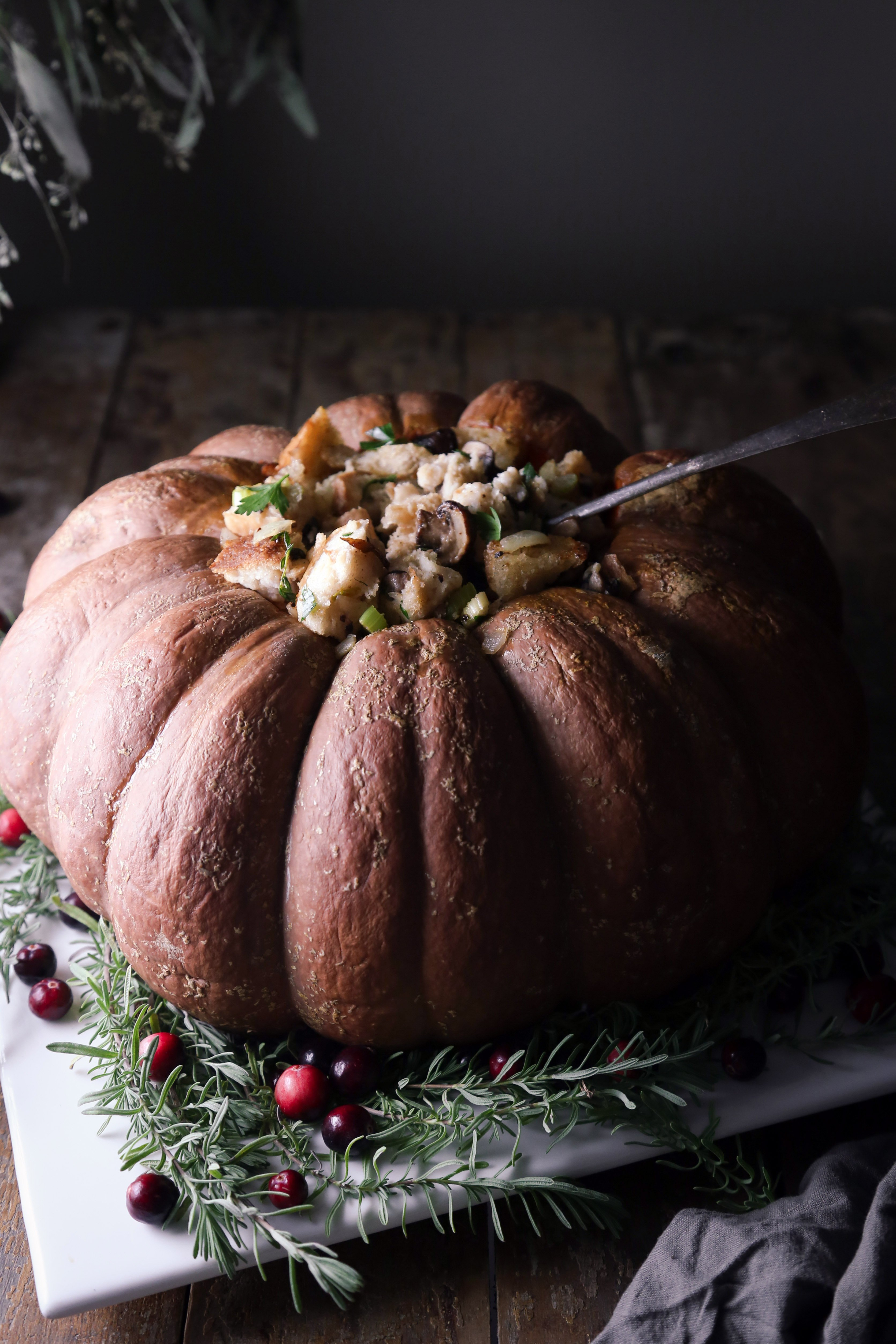 Baked Pumpkin Filled with Sourdough Stuffing | Vegetarian & vegan friendly. Can be easily adapted to be gluten and dairy free.