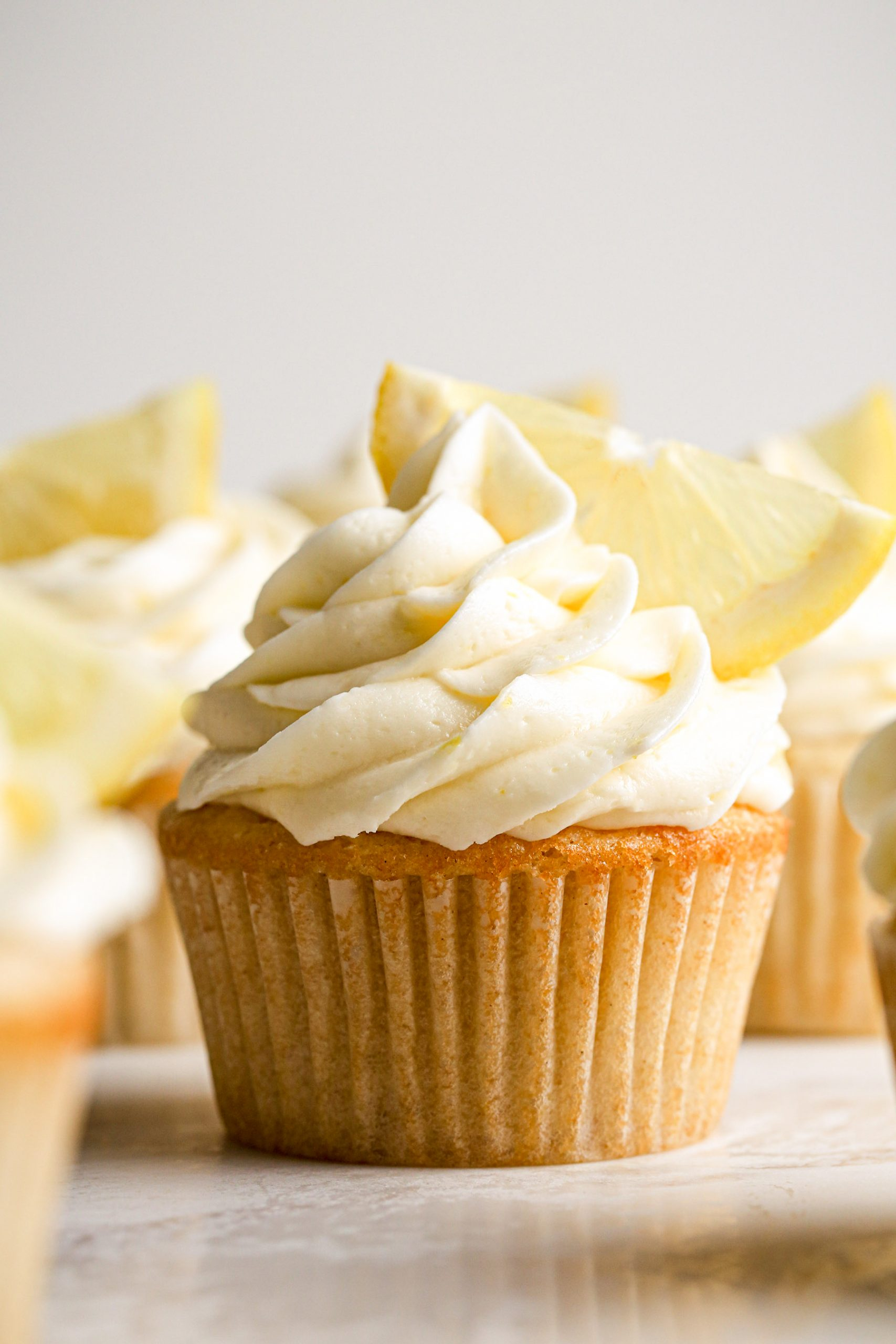 Lemon Cupcakes with Lemon Frosting Close Up | Vegan friendly with gluten free option.