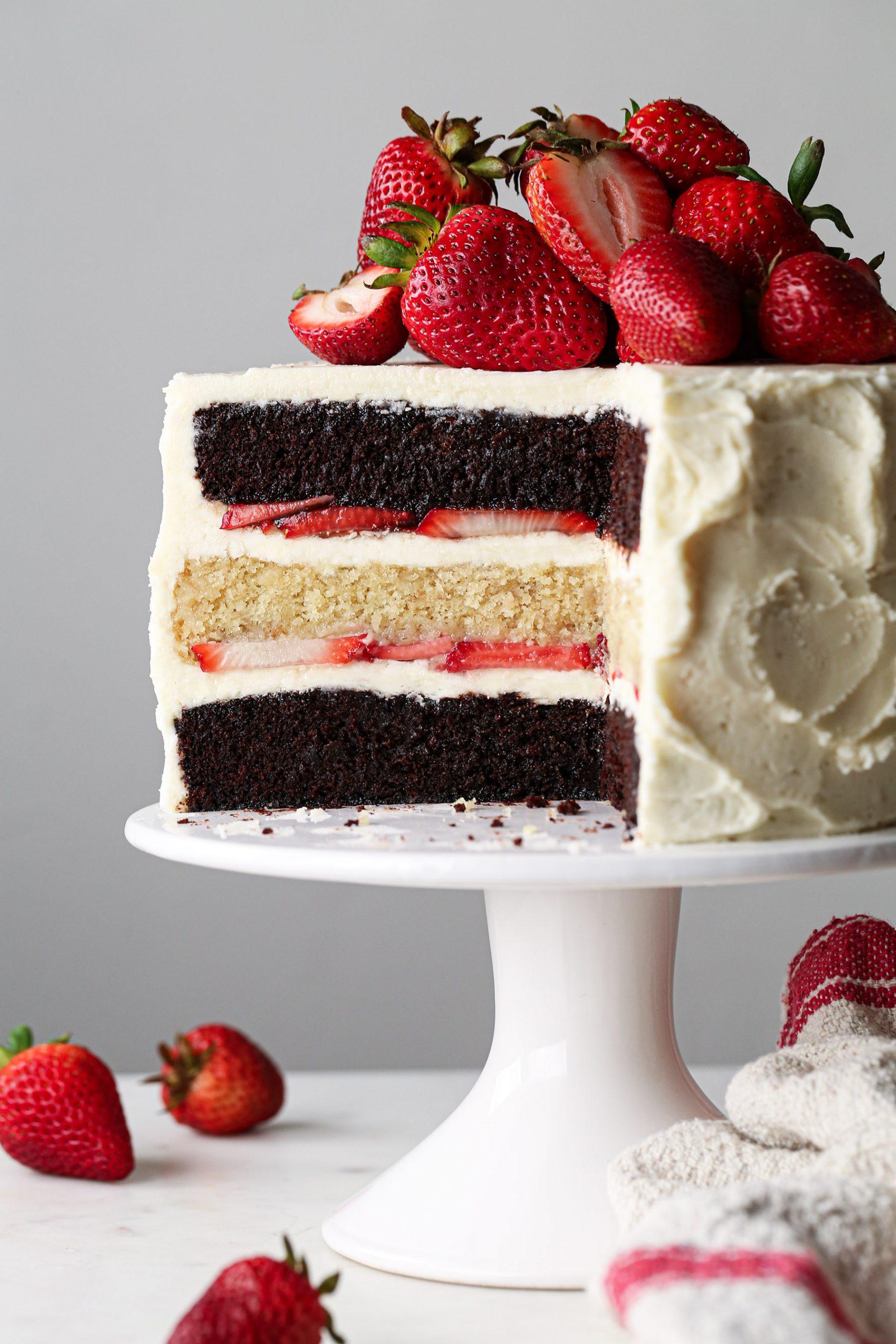 Neapolitan Cake | Chocolate and vanilla cake layered with fresh strawberries and vanilla buttercream