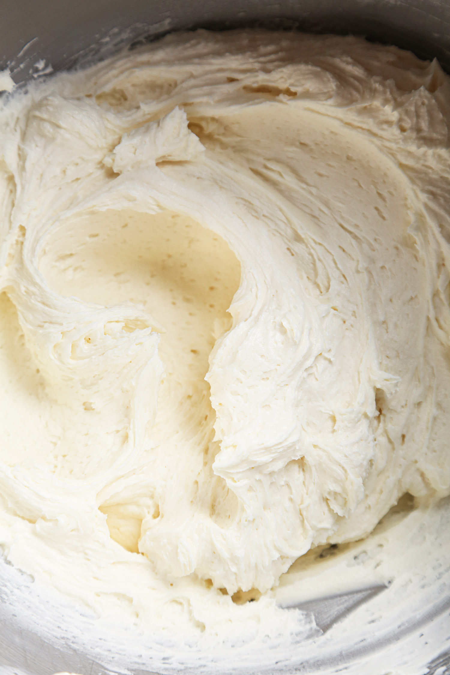 Neapolitan Cake | Fluffy vanilla buttercream in mixing bowl