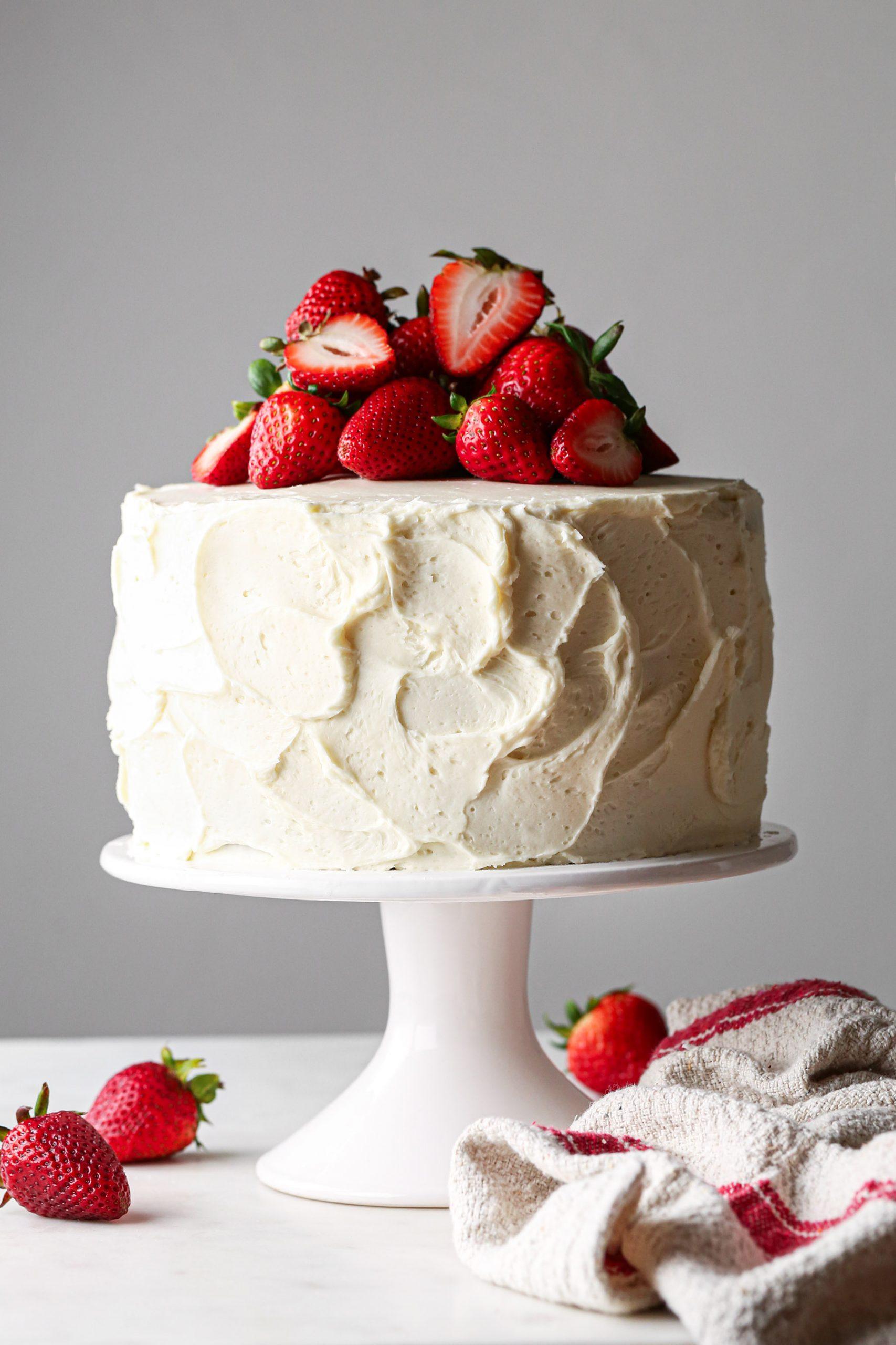 Neapolitan cake with vanilla buttercream and fresh strawberries on top