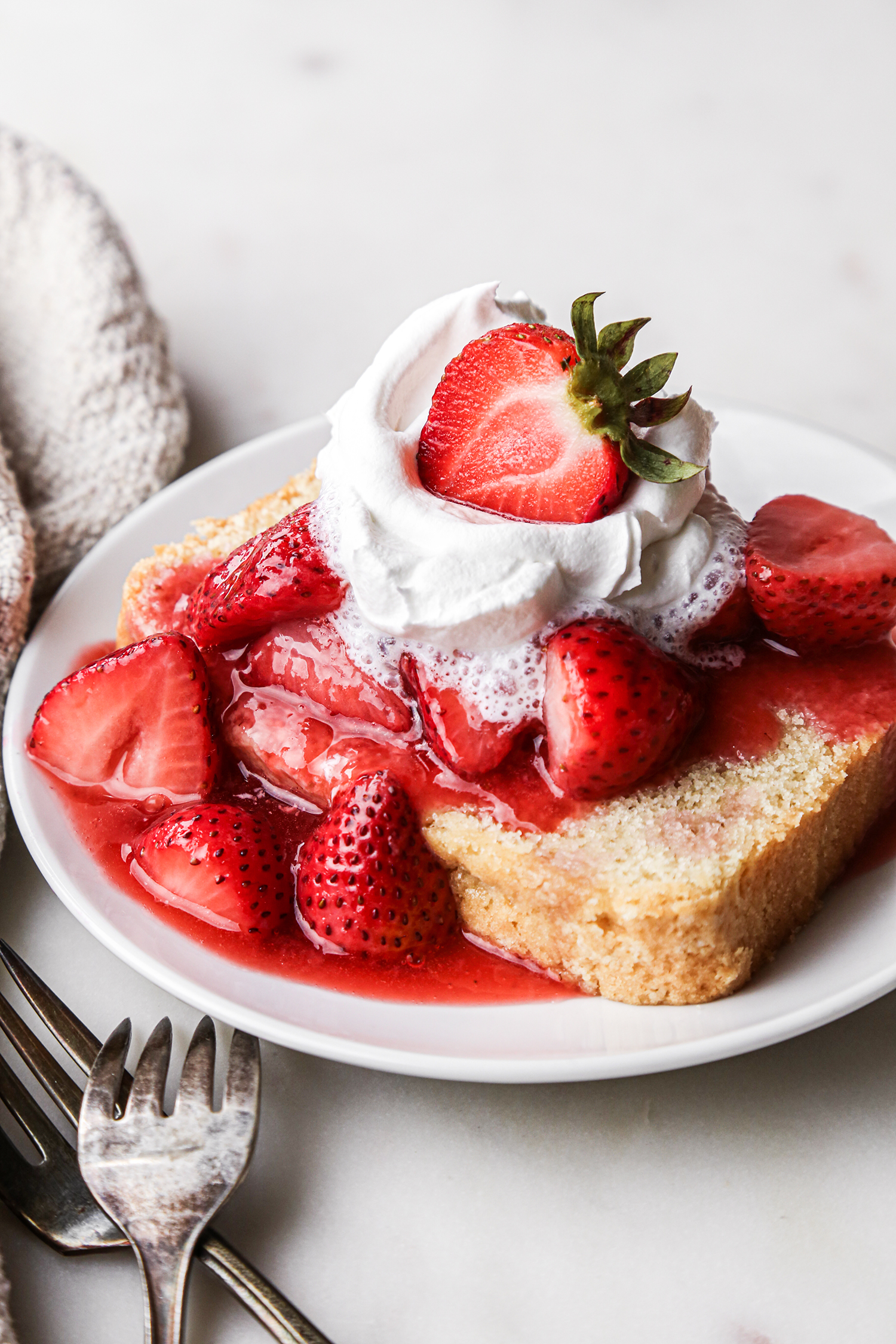 Vegan Pound Cake Slice with Strawberry Sauce and Whipped Cream