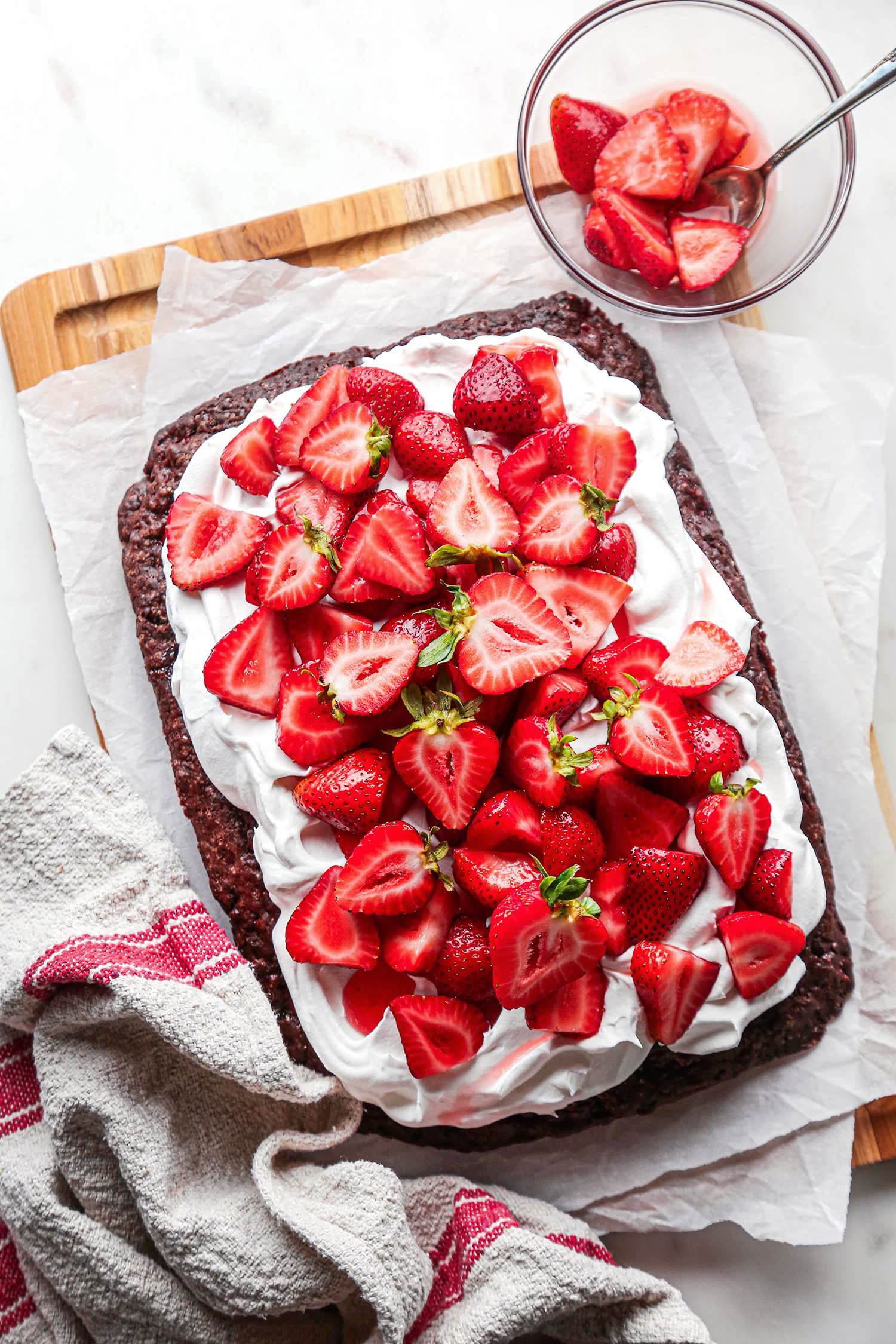 Chocolate Strawberry Shortcake Sheet Cake topped with whipped cream and fresh strawberries overhead